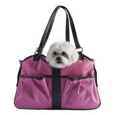 The Petote Metro dog carrier looks just like a designer handbag The Metro Bag features 2 open pockets on the front, a secure zipper pocket on the back, comfortable, adjustable shoulder straps, and is approved for airline travel on most airlines. Available in 3 sizes to accomodate dogs up to 15-po...