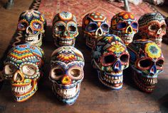 Sugar skulls with tribal designs makes me think of Mexico at Epcot (day of the dead)