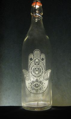 #Hamsa is an #amulet that helps banish #evil or any #negativeenergy.  It brings #happiness, #luck and #goodfortune to its owners.  Shop #BottlenSoul #Etched #Water #GlassBottles