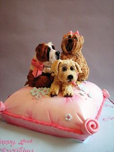 This sponge celebration cake was created for a little girl who loved her St Bernard puppy. The dogs are made from gum paste.