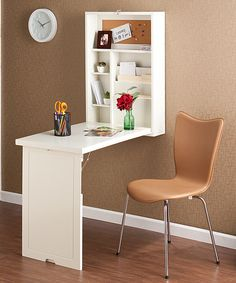 Make the most of a small space with this innovative desk. This charming piece folds out from the wall for more work space and can just as easily be packed away when not in use. Designed with two adjustable shelves, it offers a little extra storage as well.Closed: 22'' W x 32'' H x 6'' DOpen: 30'' W x 28.75'' H x 20'' DBirch veneer / medium-density fiberboardImported
