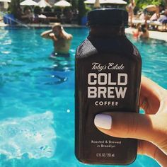 Cooling off by the pool with one of Toby's Cold Brew bottles.