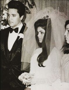 Elvis, Priscilla and her sister, Michelle, who served as Matron of Honor. Moments before the ceremony Elvis gave her a custom-made ring that He had designed; a gift to his new sister-in-law.
