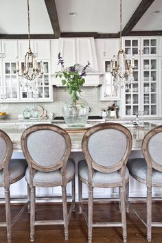 gorgeous white kitchen! And I love the antique demijohn on the island <3