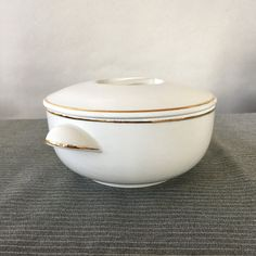 Vintage Apilco France Porcelain Casserole Dish, french cookware, white and gold, round casserole dish, french kitchen decor   Made in France  ~Details~ Pristine round casserole dish with lid from Apilco France - white porcelain with gold trim on the base, handles and lid. Produced in France, marked exclusivité Chamart France.  ~Dimensions~ Dish is 6 1/4 in diameter, 7 3/4 from handle-to-handle, 3 1/2 tall with lid. It weighs 2 lbs 3 oz unboxed.  ~Markings~ Apilco, Porcelaine a ...