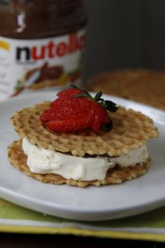 Frozen COOL WHIP and Nutella ... on pizelle cookies, or maybe frozen waffles might work too. Yum!