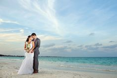 Newlyweds on the beach after their destination wedding at @Aimée Marté Maroma in the Riviera Maya. Mexico wedding photographers Del Sol Photography
