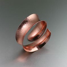 Elegant and exotic with raw, natural appeal, this handmade Chased Copper Cuff is exquisite from every angle. The hand-hammered chasing adds a distinctive texture that compliments the sleek anticlastic design. Cuff bracelets are the perfect way to add individuality to any ensemble for any occasion. #7th #Wedding #Anniversary Gift Ideas