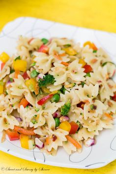 This light summer pasta salad loaded with fresh veggies bursts with flavor and a little bite at the end!