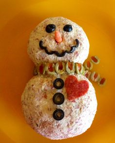 Love the olive smile on this snowman cheeseball!