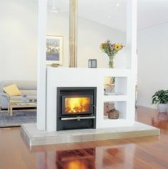 The elegance and atmosphere that stems from making your fireplace a centrepiece creates a room worth living in. A double sided fireplace can provide a Double Sided Stove, Double Sided Fireplace, Home Fireplace, Living Room With Fireplace, Fireplaces, Hanging Fireplace, Brick Fireplace, Contemporary Gas Fires, Mid Century Modern Kitchen