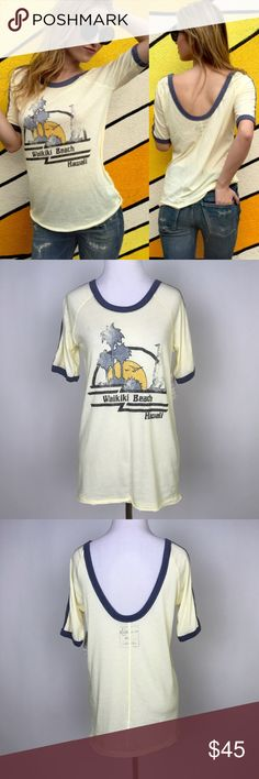 """[Free People] Island Graphic Tee Low Back Waikiki Beachy Boho graphic tee by We The Free from Free People. Ballet neck with scoop back. Ringer trim. Vintage style Waikiki Beach Graphic on front.   Fabric: 52% Cotton 48% Polyester  Bust: 36"""" Length: 26"""" Condition: NWT. Retail $68.  *J11 Free People Tops Tees - Short Sleeve"""