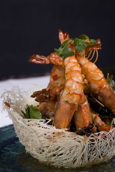 This prawn appetizer is stunning. King prawns are cooked with tomatoes, white wine, cilantro and more, and then served on a bed of salad in a noodle basket. If you are looking for fancy appetizer recipes with prawns, this one really is amazing. This is not a difficult recipe at all. The noodle baskets are simple to make, because you just need to cook the noodles and deep fry them to set them into shape.