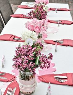 white dinner table with pink flower centerpieces!