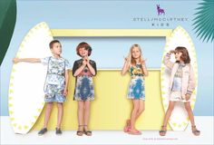A solid blue backdrop allows for imaginative props to set the scene in the Stella McCartney Kids campaign. Paper-made tropical fruit, flowers, surfboards and pirate ships take kids away on a summer vacation without ever leaving the studio set. Colorful printed dresses and separates complement the warm-weather props. (Spring Summer 2013)