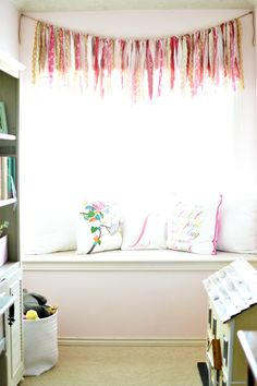 built in window seat with garland window treatment