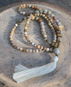 Mala necklace made of 6 and 8 mm - 0.236 and 0.315 inch, beautiful frosted agate gemstones. Together they count as 108 beads. The mala is decorated with faceted labradorite and the guru bead is a jade gemstone - look4treasures on Etsy