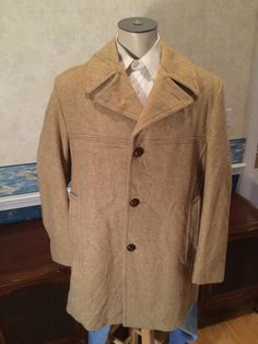 Brand: CausalCraft of New York  This 1970s overcoat features wide lapels, a high gorge, three button closure, hand warming pockets, and is made of a heavyweight heather khaki fabric.   ~Collie Clothiers  *This jacket is in good, vintage condition*   Chest (Across front, pit to pit, doubled): 46 Shoulder width: 19 Length (Bottom of collar to lower hem): 34 Sleeve Length (Shoulder seam to cuff): 26 Waist (Across front, below second button from the bottom, doubled): 44  Be sure to check out…