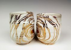 tiffany tang:  Malachite pattern cups Porcelain and gold luster Soda Fire, Cone 10 gas reduction; Cone 018 By Tiffany Tang