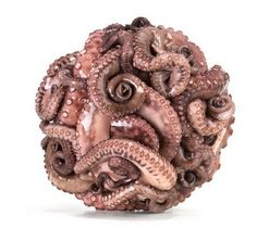 With amazing skills and a whacking taste, Nir Adar re-created the Japanese Temari thread ball from octopus tentacles. It looks so real that you can almost feel the slime on the surface.