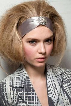 Aw12 trends - Bouffants  The retro bouffant. Hair is rolled and tucked under for extra dimension.  AW12 Oscar de la Renta.