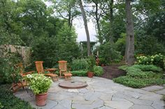 Tranquil Escapes - traditional - patio - chicago - Rocco Fiore & Sons, Inc - recessed bluestone fire-pit surrounded by a thick irregular bluestone Fire Pit Backyard, Backyard Patio, Stone Patio Designs, Flagstone Patio, Slate Patio, Modern Garden Design, Front Yard Landscaping, No Grass Landscaping, Landscaping Design