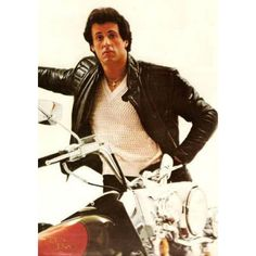 RockyIII Sylvester Stallone Motorcycle Leather Jacket  Young and suave hot blooded youth demands scaling the greatest of heights which cannot be better tested other than the boxing ring. Rocky Balboa shows off his muscles in his Black Leather Biker Jacket which does equal justice to exhi