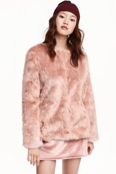 Faux fur jacket: Collarless faux fur jacket with a round neck, hook-and-eye fasteners at the front and a satin lining.