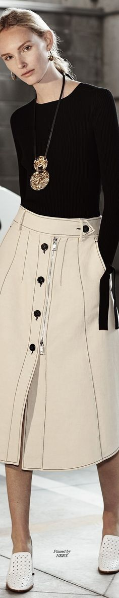 Sportmax R-17: sweater with bow in cuffs, pendant, white skirt with black seams.