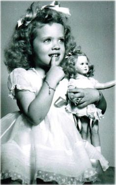 American girl and her look-alike doll./ I believe this is an American Child doll by F&B