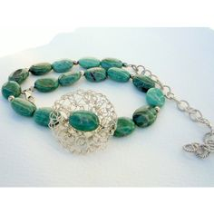 Gemstones and silver necklace, crochet focal flower,green gemstones... (€87) ❤ liked on Polyvore featuring jewelry and necklaces