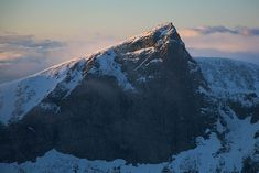 Galdhøpiggen (Galdhø Peak) is the highest mountain in Norway, Scandinavia and Northern Europe, at 2,469 m (8,100 ft) above sea level. It is located within the municipality of Lom (in Oppland), in the Jotunheimen mountain area.