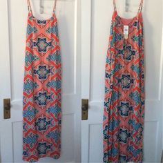 Gianni Bini maxi dress Brand new never been worn. Salmon and teal multi patterned Aztec maxi dress. Was given to me as a gift but is just a bit too small. There is a slit down both sides about knee high, and a built in slip. Gianni Bini Dresses Maxi