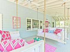 THE SALTY MERMAID COTTAGE: This home features a relaxing porch with two swinging beds. Perfect for lounging in or sleeping under the stars.