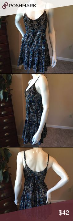 Free People S floral beaded flounce tunic Free People S floral beaded flounce tunic. Blue and black silver beaded top or mini dress. Great with leggings and boots. Measurements will be posted soon Free People Dresses Mini