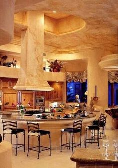This is a fantasy kitchen indeed - the colors and feel make it so warm and inviting, you just have to cook something up!