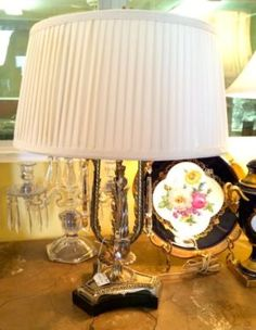 "1950's Lamp With Seven Inch Crystal Prisms  24"" Tall   $175  Butler Creek Antiques Dealer #8804  Lucas Street Antiques 2023 Lucas Dr. Dallas, TX 75219  Like us on Facebook: https://www.fa"