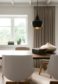 Countryhouse interior with Flow chairs from MDF Italia and Beat lights from Tom Dixon