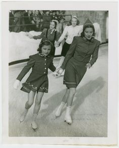 Woman and girl skating together