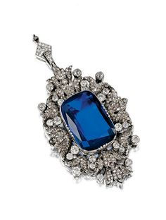 SAPPHIRE AND DIAMOND PENDANT. Set at the centre with a cushion-shaped sapphire, within an open work frame of stylised floral design set with cushion-shaped and rose-cut diamonds, the pendant fitting set with single-cut stones.
