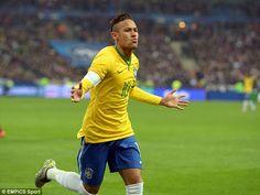 The Barcelona star runs away in celebration having scored Brazil's second during the 3-1 win over France