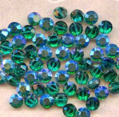 Vintage Swarovski Emerald AB 5100 Crystal Beads by PickleValentine