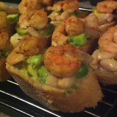 Crustinis with shrimp, lime, cilantro, white beans and avocado.
