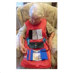 This Alzheimer's Activity apron is a useful for people with active hands who sit, a useful care home activity for elderly people with dementia in care homes