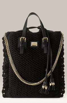 Dolce & Gabbana: 'Miss Helen' Crochet Chain Tote. Crochet front and back, with leather trims. Mixed metal chain shoulder strap. Top leather interior with drawstring closure ties with tassels. 16'' leather top handles with 6'' drop. Decorative buckles. Partial mesh lining. Logo engraved plaque at front. http://media-cache-ak0.pinimg.com/originals/22/70/07/2270079c6bdc5c930c7dd2b7ec0e60f2.jpg http://www.geekpurses.hk/wp-content/uploads/2010/02/dolce-and-gabbana-miss-helen-crocheted-shopper.jpg