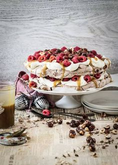 katie's chocolate pavlova with salted caramel, whiskey sauce, raspberries & caramel hazelnuts