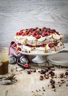 katie's chocOlate pavlova with salted caramel, whiskey sauce, raspberries & caramel hazelnuts