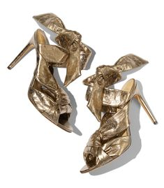 $695 Gold sandals featuring a twisted-strap knot design. ShopBazaar, shop designer clothing, shoes and accessories selected exclusively by the editors at Harper's Bazaar.