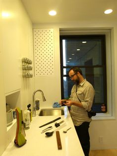 420 sq ft NYC apartment with lots of super efficient space saver ideas - love metal wall for magnetic herb containers