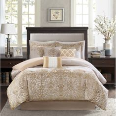 Create an opulent look in your master bedroom with the Madison Park Shauna Comforter Set. The woven jacquard design provides texture in the solid taupe portion while a the decorative motif comes up from the bottom of the bed to the center.